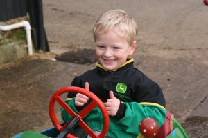 A youngster enjoys a trip around the farm