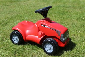 New little red Case children's toy tractor at Easton Farm Park