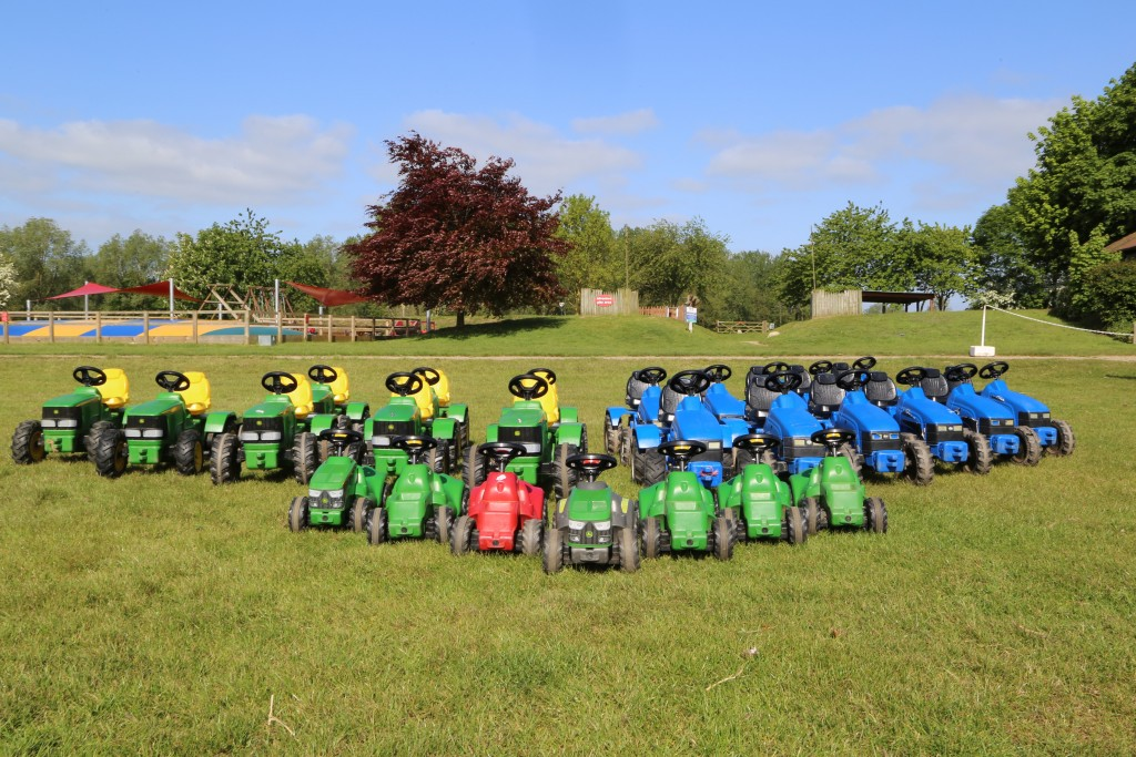 Line-up of children's toy tractors at Easton Farm Park